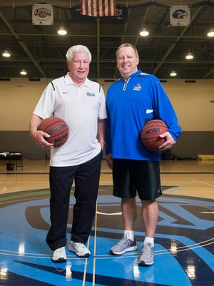 Head basketball coach Jeff Burkhamer, right, and his father Ed Burkhamer, a retired basketball coach, pose center court at the University of West Florida Field House in Pensacola on Wednesday, February 22, 2017.
