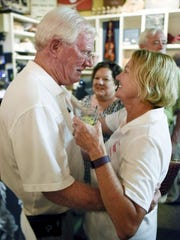 State Rep. Charles Sargent is greeted by his wife, Nancy, at Puckett's Grocery & Restaurant in Franklin on Aug. 4, 2016.