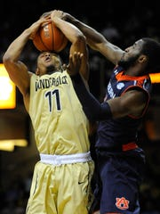 Vanderbilt freshman Jeff Roberson (11) takes the ball in his face as he pulls down a rebound over Auburn guard KT Harrell on Tuesday night.