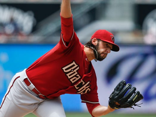 Diamondbacks starting pitcher Mike Bolsinger releases a pitch against the San Diego Padres during the first inning of a baseball game  Sunday, June 29, 2014, in San Diego.