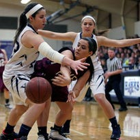 Rachel Siciliano and Kayla Gresl of Xavier try to trap Haley Fuhrmann of Fox Valley Lutheran during a WIAA Division 3 regional final girls' basketball game Saturday at Xavier.