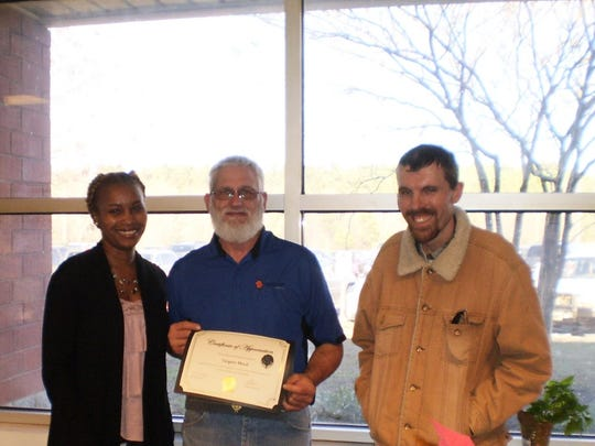 Sargent Metal accepting the award from left are TaKesha Jones James, ACDSNB Director of Day Services, Kevin Dziema, and customer services representative Chris Vickery.