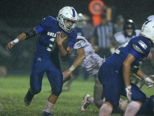 Eden's Donovan Gonzales runs the ball past Water Valley
