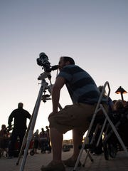 People participate in a stargazing event hosted by