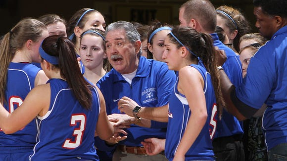 Carmel coach Dan O'Hare talks to his team during a timeout against Lourdes during the girls basketball Class AA Section 1 semifinal at the Westchester County Center in White Plains on Mar. 1, 2012.