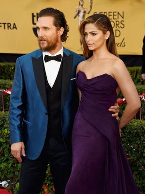 Actor Matthew McConaughey (L) and model Camila Alves attend the 21st Annual Screen Actors Guild Awards at The Shrine Auditorium on January 25, 2015 in Los Angeles, California.