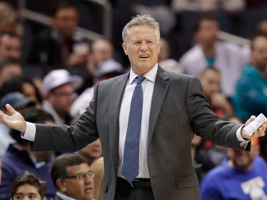 Philadelphia 76ers coach Brett Brown reacts to a call during the first half of an NBA basketball game against the Charlotte Hornets in Charlotte, N.C., Tuesday, March 6, 2018. (AP Photo/Chuck Burton)