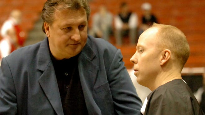 Bob Huggins and Mick Cronin in 2009.