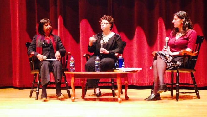 Victoria Baptiste, center, discusses the case of her great-grandmother, Henrietta Lacks, during a forum Monday at Drake University. Listening in are Shirley Lacks, left, who is Henrietta's daughter-in-law, and Drake English professor Melisa Klimaszewski, who moderated.