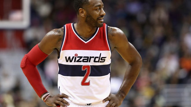 WASHINGTON, DC - NOVEMBER 26: John Wall #2 of the Washington Wizards looks on against the San Antonio Spurs in the second half at Verizon Center on November 26, 2016 in Washington, DC. NOTE TO USER: User expressly acknowledges and agrees that, by downloading and or using this photograph, User is consenting to the terms and conditions of the Getty Images License Agreement.  (Photo by Rob Carr/Getty Images) ORG XMIT: 662352895 ORIG FILE ID: 626022944