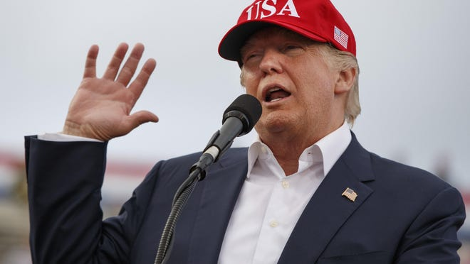 """FILE - In this Saturday, Dec. 17, 2016 file photo, U.S. President-elect Donald Trump speaks during a rally at Ladd-Peebles Stadium in Mobile, Ala. China said Saturday its military seized a U.S. Navy unmanned underwater glider in the South China Sea but it would give the drone back. But Trump tweeted later that the Chinese government should be told """"we don't want the drone they stole back"""" and """"let them keep it!"""" This comes after United States officials had confirmed that they """"secured an understanding"""" for the return of the device. Trump's evening tweet may extend one of the most serious incidents between the American and the Chinese militaries in years. (AP Photo/Evan Vucci, File)"""