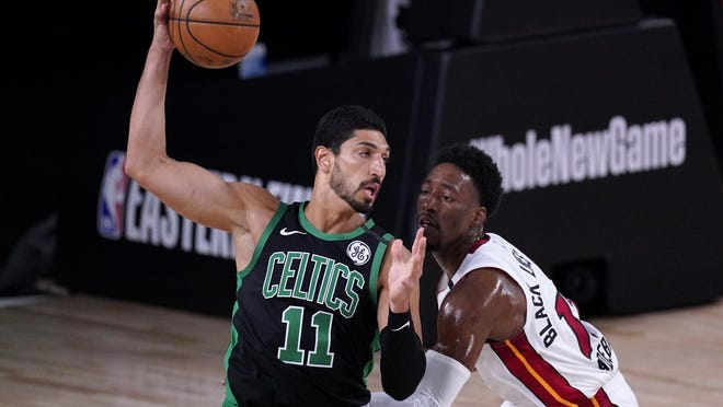 Celtics center Enes Kanter, who went 4-for-4 with nine points and six rebounds in 11 minutes, battles Heat forward Bam Adebayo during the first half of Thursday's Eastern Conference finals game.