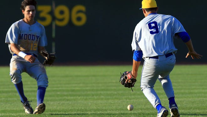 Moody's Abram Monita chases the ball against King on Friday, April 21, 2017, at Cabaniss Baseball Field in Corpus Christi.