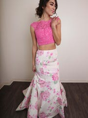 Model, Sophie Puente wearing a pink petal print two-piece dress from Soirée Couture ($699).