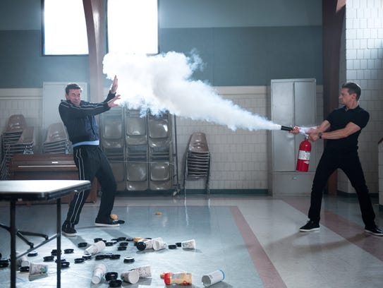 Jerry (Jeremy Renner) brandishes a fire extinguisher