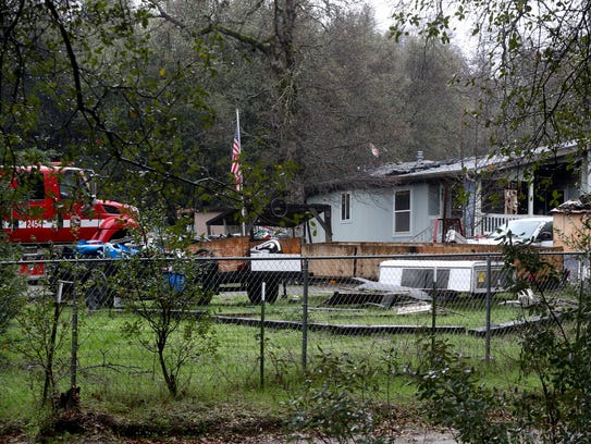 The Bella Vista Court home where the bodies of four people were found following a Sunday night fire.