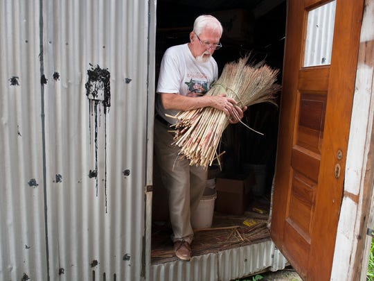 Sam Moyer of Mount Laurel carries broomcorn that he