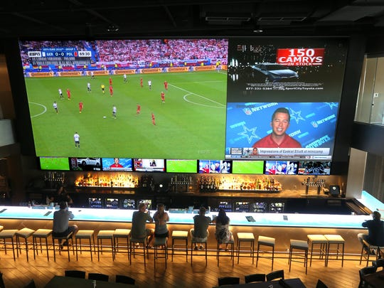 A 38-foot wide television screen makes watching sports