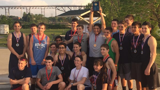 The Wappingers boys crew team celebrates its Dutchess Cup on Tuesday.