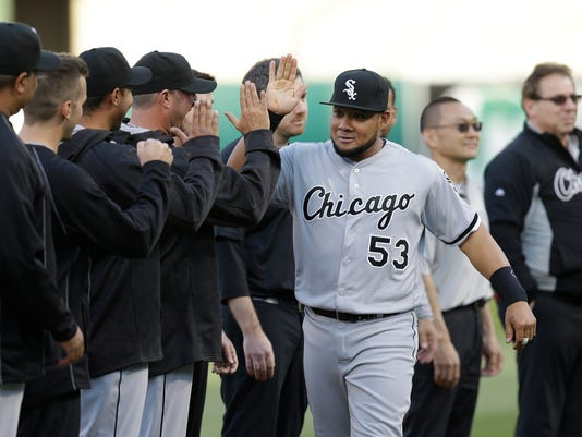 Chicago White Sox's Melky Cabrera (53) is welcomed onto the field by teammates prior to the baseball game against the Oakland Athletics on Monday, April 4, 2016, in Oakland, Calif. (AP Photo/Ben Margot)