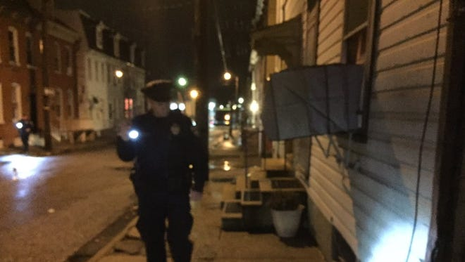 Police sought the area around the 200 block of Hartley St. in York city Sunday night after a shooting event around 8:30 p.m. Three evidence placards were visible.