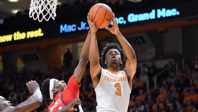 Tennessee's Robert Hubbs III, right, drives to the basket against Mississippi's Rasheed Brooks during the first half Wednesday at Thompson-Boling Arena.