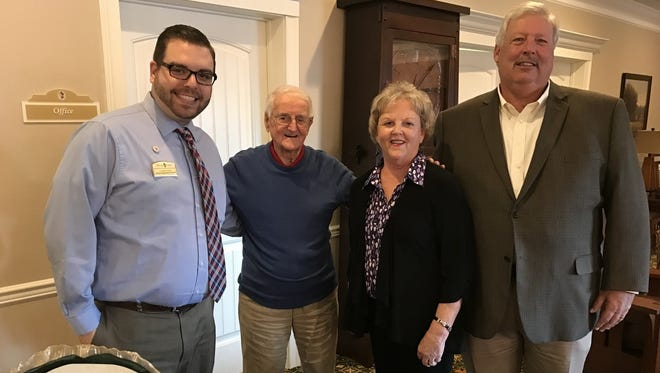 Tyner Brooks, senior executive director, George Williams, Morning Pointe of Brentwood resident, Rhonda Travis and Brentwood City Commissioner Ken Travis celebrate parent company Morning Pointe Senior Living's 20th anniversary at Morning Pointe of Brentwood.
