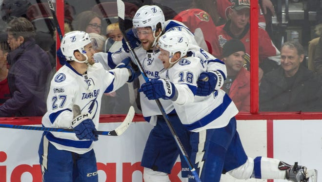 Tampa Bay Lightning defenseman Victor Hedman (77) celebrates his overtime goal against the Ottawa Senators with teammates.