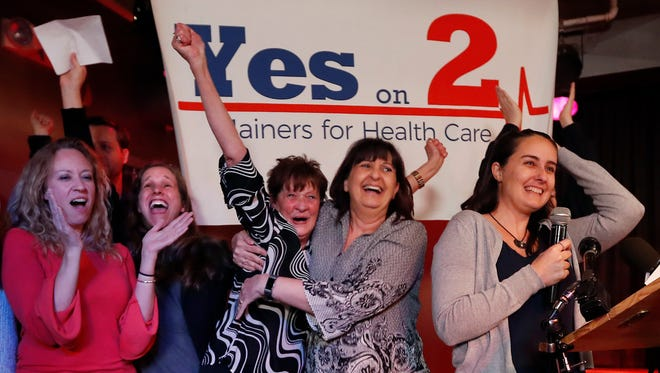 Medicaid expansion supporters celebrate victory, Portland, Maine, Nov. 7, 2017.