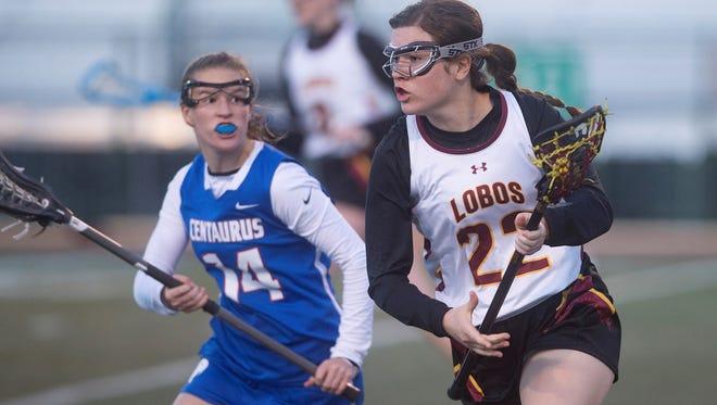 Rocky Mountain High School's Caroline Tychsen works against a Centaurus defender during Wednesday night's game at French Field. Centaurus won the game 17-6.