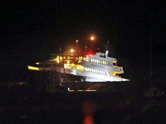 A high-speed ferry sits next to the Hyannisport breakwater after striking a jetty in Hyannisport, Mass., on Friday, June 16, 2017. The ferry Iyanough hit the jetty and grounded on the rocks at the Hyannis Harbor entrance around 10 p.m. Friday.