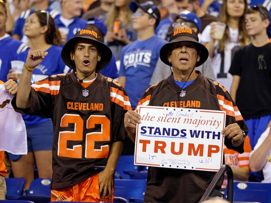 Cleveland Browns fans hold a sign following the national