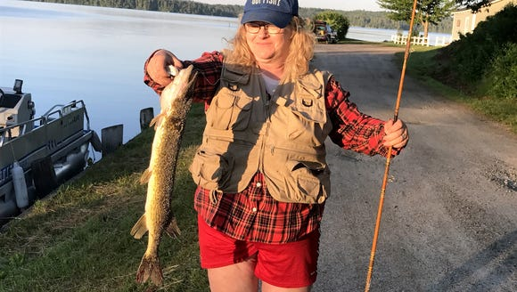 Carol's first catch in New Hampshire was this big pickerel.