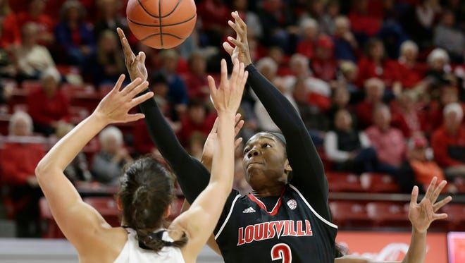 Louisville's Myisha Hines-Allen (2) drives to the basket against North Carolina State's Aislinn Konig (1) during the first half of an NCAA college basketball game in Raleigh, N.C., Sunday.