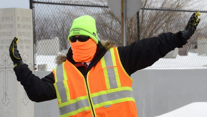 Heather Gardner, a security guard at an elementary School in Hazleton, Pa., braves cold temperatures Feb. 6, 2015, while directing traffic.