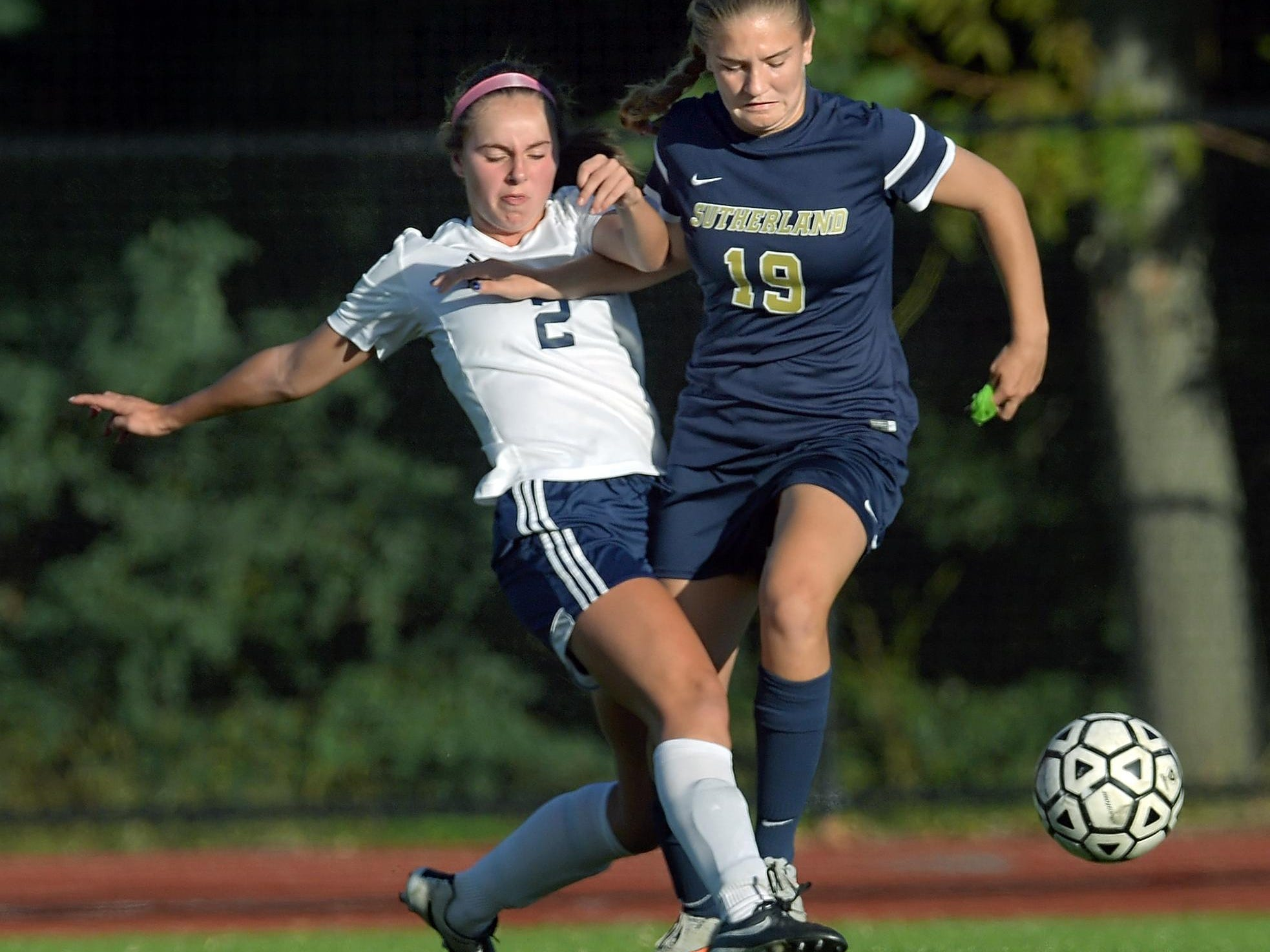 Mercy's Diana Colpoys, left, tackles the ball away from Pittsford Sutherland's Grace Allen.