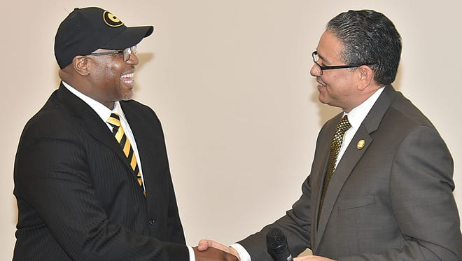 New Grambling athletic director Paul Bryant, left, is introduced by GSU president Rick Gallot on Tuesday morning at the Eddie Robinson Museum.