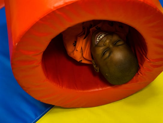 Joey Hampton enjoys being rolled around in a tunnel