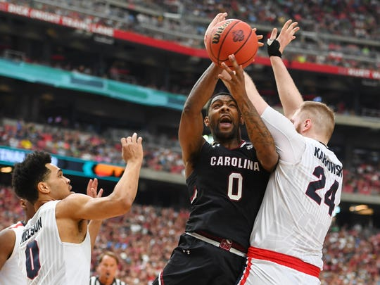 South Carolina Gamecocks guard Sindarius Thornwell (0) shoots between Gonzaga Bulldogs guard Silas Melson (0) and center Przemek Karnowski (24) in the first half in the semifinals of the 2017 NCAA Men's Final Four at University of Phoenix Stadium.