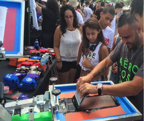 Impress Ink does live-screen printing at the Orlando Speed World Dragway October 2015.