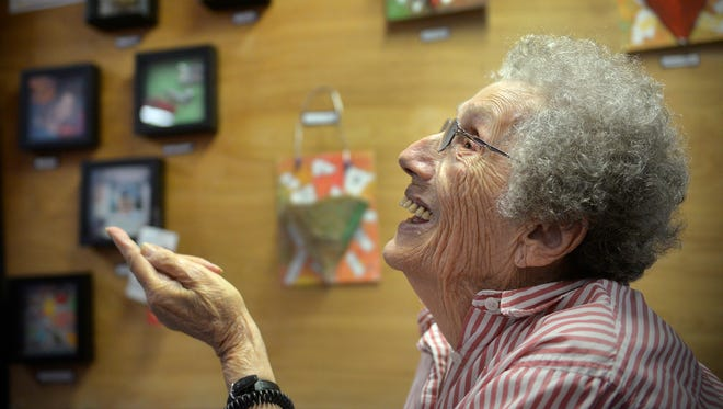Good Shepherd senior living center resident Bev Killeen smiles Tuesday, Nov. 24 as talks about a shadow box that she made during the Art A La Carte program. The Paramount Arts District program helped give seniors exposure to a variety of art forms over a nine month period.