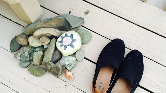 Slippers sit beside stones at a retreat center.