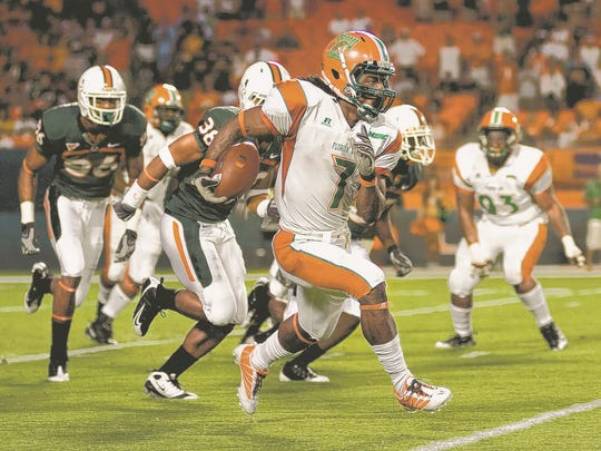 FAMU's LeRoy Vann returns a kickoff against the Miami Hurricanes.