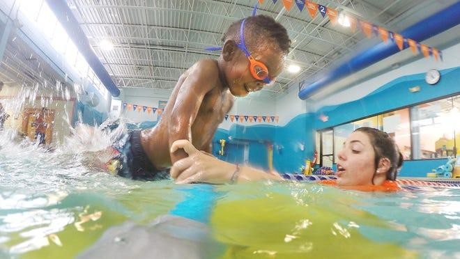 Thomas Danforth, 4, takes a swim class with instructor Moriah Potter at the Goldfish Swim School in Birmingham.