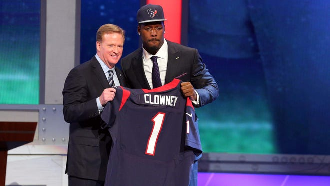 Jadeveon Clowney (South Carolina) poses for a photo with commissioner Roger Goodell selected as the number one overall pick in the first round of the 2014 NFL Draft to the Houston Texans at Radio City Music Hall.