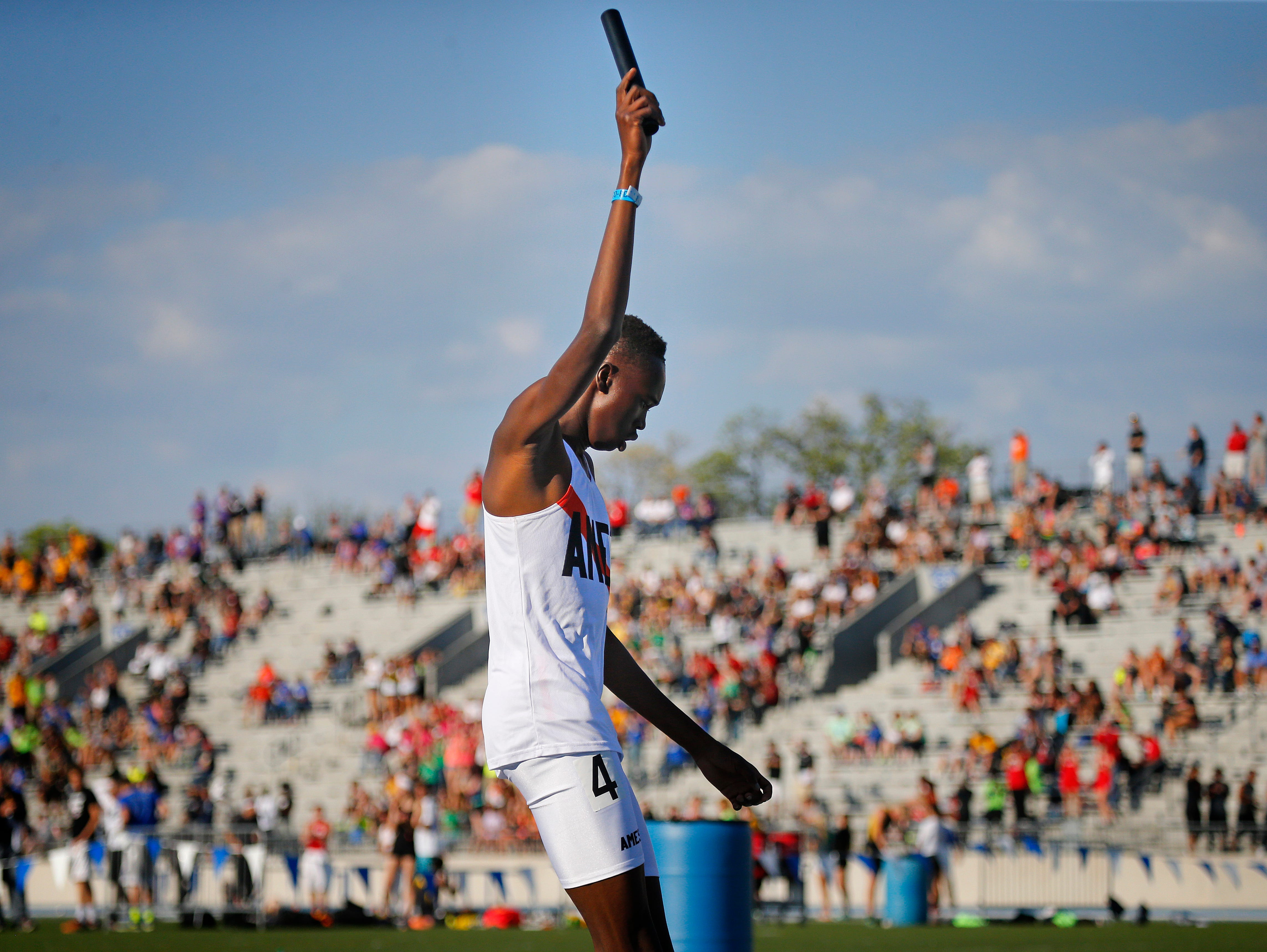 Daniel Chan, anchor of Ames' 4 x 800 relay, celebrates setting a new state record at the state boys' track meet Thursday. The Little Cyclones posted a time of 7:41.43.