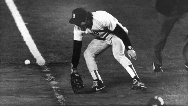 Red Sox first baseman Bill Buckner misplays the ball during Game 6 of the World Series against the Mets.