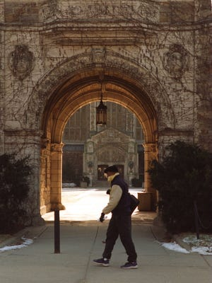 A student walks past one of the ivy-covered buildings (in the summer) on the campus of the University of Michigan in Ann Arbor in this Free Press file photo.
