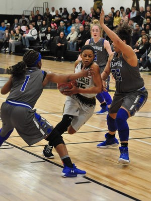 Abilene High's Triniti Wilson tries to fight through a pair of Weatherford defenders during the Lady Eagles' 37-35 loss Friday at Eagle Gym.