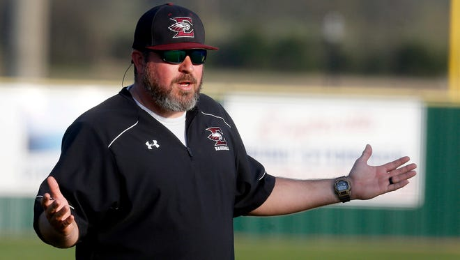Eagleville's head coach Travis Holland questions a call during a game against Moore County on Monday, April 2, 2018, at Eagleville.